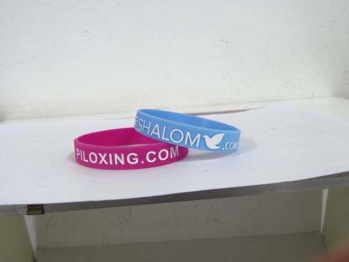 Which site has lowest price for embossed wristband?