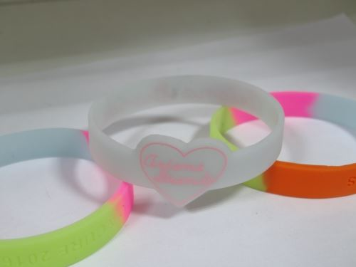Which site has lowest price for debossed wristbands?